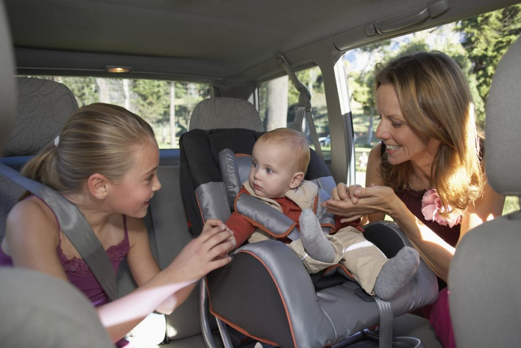 Mother and Daughter with Baby in Car